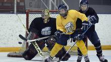 Members of the UBC Thunderbirds women's hockey team practise ahead of the CIS Women's hockey tournament at Varsity Area on March 6 2013. (Fred Lum/The Globe and Mail)