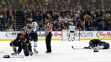 Patrik Laine of the Winnipeg Jets lays on the ice after a hit by Jake McCabe of the Buffalo Sabres on Jan. 7, 2017. (Kevin Hoffman/Getty Images)