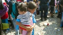 Refugees in camps across Europe do not need your used goods. (ROBERT ATANASOVSKI/AFP/Getty Images)