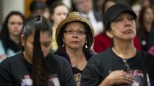 Relatives listens to Wally Oppal give his report in Vancouver December 17, 2012 into the Missing Women Commission of Inquiry. (John Lehmann/The Globe and Mail)