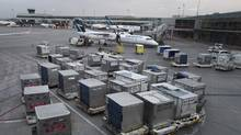 Cargo and baggage containers at the gates at Toronto Pearson Airport. (Fred Lum/The Globe and Mail)
