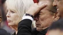 Los Angeles Clippers owner Donald Sterling (R) puts his hand over his face as he sits courtside with his wife Shelly (L) while the Clippers trail the Chicago Bulls in the second half of their NBA basketball game in Los Angeles December 30, 2011. (© Danny Moloshok / Reuters)
