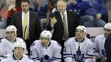 Toronto Maple Leafs head coach Randy Carlyle, back right, shouts to his players during the third period of an NHL game against the New Jersey Devils Sunday, March 23, 2014, in Newark, N.J. (Mel Evans/AP)
