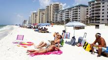Tourists crowd the beach in Perdido Key, Fla. (Sean Gardner/Reuters)