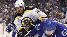 Boston Bruins right wing Nathan Horton (18) collides with Vancouver Canucks center Ryan Kesler (17) during the first period of Game 2 of the NHL Stanley Cup hockey playoff in Vancouver, British Columbia, June 4, 2011. (BEN NELMS/Reuters)