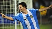 Argentine footballer Lionel Messi reacts after a goal during a friendly match against Nigeria. (MUNIR UZ ZAMAN/AFP/Getty Images)