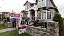 A newly sold property is pictured in a Vancouver neighbourhood on Sept. 9, 2014. (Julie Gordon/REUTERS)