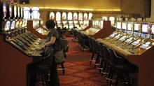 A tourist plays a slot machine at the MGM Grand in Las Vegas, Nov. 18, 2008. (Jae C. Hong/AP/Jae C. Hong/AP)