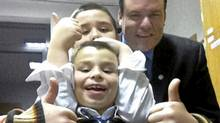 Christopher Watkins, 7, Alexander, 10 and father Stephen shown together in Warsaw, Poland. After two years spent searching for his missing sons, Mr. Watkins hopes a Polish court will let them come home.