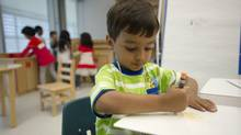 Four-year-old Zain Siddiqui settles in at his first day of all-day kindergarten at Fraser Mustard Learning Academy in Toronto on Sept. 3, 2013. (KEVIN VAN PAASSEN/THE GLOBE AND MAIL)