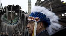 Aboriginal chiefs stand at the main gate to Parliament Hill during a protest Friday January 11, 2013 in Ottawa. (Adrian Wyld/THE CANADIAN PRESS)
