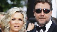 "Cast member Russell Crowe and his wife Danielle Spencer arrive for the screening of ""Robin Hood"" by director Ridley Scott and for the opening ceremony of the 63rd Cannes Film Festival in this May 12, 2010 file photograph. (Reuters)"