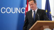 British Prime Minister David Cameron pauses before speaking during a media conference after an EU summit in Brussels on Friday, June 27, 2014. (Yves Logghe/AP)