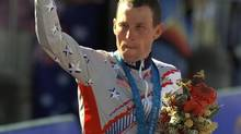 U.S. cyclist Lance Armstrong waving after receiving the bronze medal in the men's individual time trials at the 2000 Summer Olympics (RICARDO MAZALAN/The Associated Press)