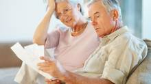 Senior man and woman worrying about retirement (photos.com)