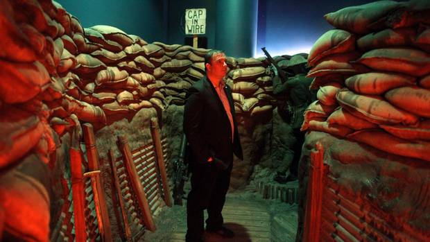 Historian Tim Cook stands in mock trenches on display at the Canadian War Museum's Vimy Ridge exhibit in Ottawa on Monday.