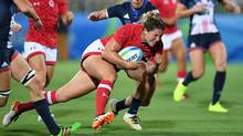 Canada's Kelly Russell runs in for a try against Great Britain during the bronze medal match in women's rugby sevens at the Rio Olympics on Aug. 8, 2016. (Sean Kilpatrick/The Canadian Press)