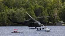 Canadian military helicopter and police boat patrol Peninsula Lake on the eve of leaders arriving at the Muskoka 2010 G8 summit at the Deerhurst Resort in Huntsville, Ont. (Sean Kilpatrick/The Canadian Press)