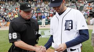 Home plate umpire Jim Joyce, left, shakes hands with Detroit Tigers pitcher Armando Galarraga while handing the lineup card on the field before the Detroit Tigers-Cleveland Indians MLB baseball game in Detroit, Thursday, June 3, 2010. Galarraga lost his bid for a perfect game with two outs in the ninth inning on a disputed call at first base by Joyce on Tuesday night. (AP Photo/Paul Sancya)