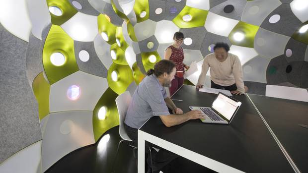 The FabPod at the Royal Melbourne Institute of Technology Design Hub turns a meeting room into a cavern formed by a cluster of bubbles.