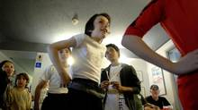 Cesar Corrales, left, Ethan Colangelo, centre, and Liam Redhead listen to instructions at the Toronto audition for Billy Elliot.