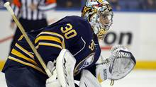 Buffalo Sabres goalie Ryan Miller (30) tries to find the puck during the first period against the Vancouver Canucks at First Niagara Center. (Timothy T. Ludwig/USA Today Sports)