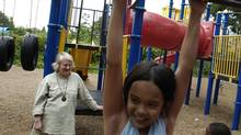 Cheryl Paige school principal of Joyce Public School seen in the playground of the school with children playing. July 22, 2005 (Louie Palu/The Globe and Mail)