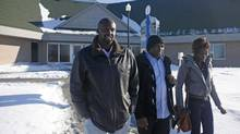 University of Moncton recruiter Cheick Konate, left, on the campus with students Idrissa Dembele, 22, and Assa Traore, 18. , on Friday January 18, 2013. (Please credit to Globe and Mail without photographer's name)