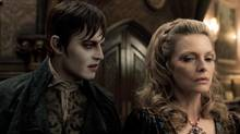"Johnny Depp and Michelle Pfeiffer in a scene from ""Dark Shadows"" (Handout)"