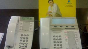 Phone setup by Aastra Technologies at insurer Aviva, with a picture of Indian cricket star Sachin Tendulkar, who is the brand ambassador for Aviva.
