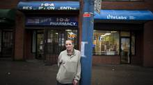 Laura Shaver, president of the B.C. Association of People on Methadone, and a methadone user herself, is photographed outside a pharmacy that supplies patients with methadone in Vancouver, B.C., Tuesday, December 31, 2013. (Rafal Gerszak/The Globe and Mail)