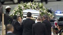 Pallbearers place Whitney Houston's casket into a hearse at the New Hope Baptist Church in Newark, N.J., on Saturday. (Lucas Jackson/Reuters)