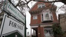 A house with a for sale sign is seen in the Cabbagetown neighbourhood in Toronto in this file photo. (Matthew Sherwood For The Globe and Mail)