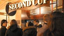 Customers line up at a Second Cup outlet in Toronto in this file photo. (Deborah Baic/The Globe and Mail)