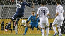 Vancouver Whitecaps's Matt Watson(16) shoots against Los Angeles Galaxy goalkeeper Josh Saunders in the second half of an MLS game in Carson, Calif., Thursday, Nov. 1, 2012. The Galaxy won 2-1. (Jae C. Hong/AP)
