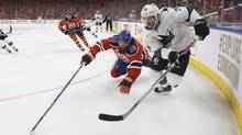 San Jose Sharks' Jannik Hansen and Edmonton Oilers' Patrick Maroon vie for the puck during Game 1 on Wednesday. (JASON FRANSON/THE CANADIAN PRESS)