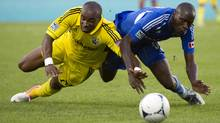 Montreal Impact's Hassoun Camara and Columbus Crew's Emilio Renteria battle for possession of the ball during first half MLS action in Montreal, Sunday, July 8, 2012. (The Canadian Press)