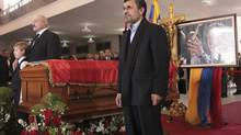 Iran's President Mahmoud Ahmadinejad stands next to the coffin of Venezuela's late President Hugo Chavez, during the funeral service at the Military Academy in Caracas March 8, 2013. (HANDOUT/REUTERS)