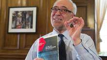 Quebec Finance Minister Carlos Leitao displays his budget speech, on the eve of a provincial budget speech on Monday in Quebec City. (Jacques Boissinot/The Canadian Press)