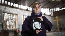 'Why do these terrorist acts keep happening again and again? Why are the terrorists getting stronger?' asks Susanna Dudieva, director of the Mothers of Beslan, standing in Middle School No. 1, where her 13-year-old son Zaur was killed. (John Lehmann/The Globe and Mail)
