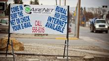 "A sign on the main street in downtown Olds, Alta., advertises ""rural high-speed"" Internet (Chris Bolin Photography Inc. For The Globe and Mail)"