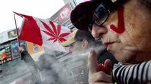 "Pot smokers gather in downtown Toronto for the annual ""4:20"" rally on April 20, 2011. (Peter Power/Peter Power/The Globe and Mail)"