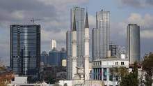 Residential towers are seen behind a mosque in Istanbul's Sisli district in this Sept. 3, 2012 file photo. Turkey is no longer paying ratings agency Standard & Poor's to provide a full ratings service. (MURAD SEZER/REUTERS)