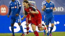 Toronto FC midfielder Torsten Frings (22) celebrates after scoring the first goal in a 3-0 victory over the Montreal Impact during second half Major League Soccer action in Montreal on Wednesday, June 27, 2012. (Ryan Remiorz/THE CANADIAN PRESS)