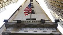 In this Friday, Nov. 13, 2015, photo, the American flag flies above the Wall Street entrance to the New York Stock Exchange, in New York. (Richard Drew/AP)
