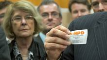 Montreal MP Thomas Mulcair holds up his membership card at a news conference announcing his candidacy for the NDP leadership on Oct. 13, 2011. (Ryan Remiorz/Ryan Remiorz/The Canadian Press)