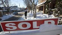 A house that has been sold in Toronto's East end on Dec. 16, 2013. (Deborah Baic/The Globe and Mail)