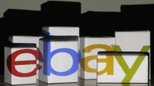 An eBay logo is projected onto white boxes in this illustration picture taken in Warsaw, January 21, 2014. (KACPER PEMPEL/REUTERS)