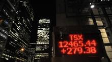 The Ontario Securities Commission has publicly stated it is going to be more aggressive on insider issues. Electronic stock ticker outside Scotia Plaza showing gains made by the TSX after the Euro debt crisis was staunched by a $ 1 trillion stimulus package. File photos of downtown Toronto's financial district and area taken at night on Oct 27 2011. (Fred Lum/The Globe and Mail) (Fred Lum/The Globe and Mail)