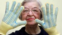 Stephanie Kwolek, 83, is shown in 2007 wearing regular house gloves made with Kevlar, the ultrastrong fibre that she invented. (THE NEWS JOURNAL/JENNIFER CORBET/ASSOCIATED PRESS)